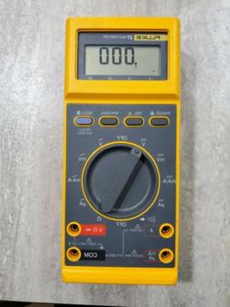 27 fm multimeter with case leads